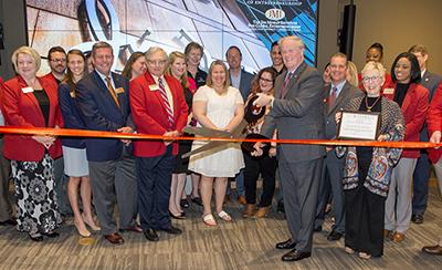 President John Thrasher prepares to cut the ribbon celebrating FSU's new entrepreneurship-focused Jim Moran Building.
